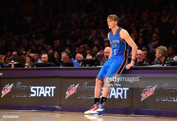 Kyle Singler of the Oklahoma City Thunder waits to enter the game against the Los Angeles Lakers at Staples Center on December 23 2015 in Los Angeles...