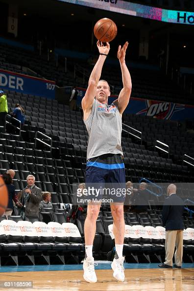 Kyle Singler of the Oklahoma City Thunder warms up before the game against the Denver Nuggets on January 7 2017 at Chesapeake Energy Arena in...
