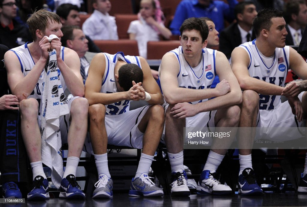 Kyle Singler #12, Seth Curry #30, Ryan Kelly #34 and Miles Plumlee #21 of the Duke Blue Devils look on from the bench against the Arizona Wildcats during the west regional semifinal of the 2011 NCAA men's basketball tournament at the Honda Center on March 24, 2011 in Anaheim, California.