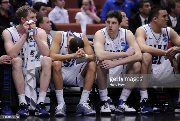Kyle Singler Seth Curry Ryan Kelly and Miles Plumlee of the Duke Blue Devils look on from the bench against the Arizona Wildcats during the west...