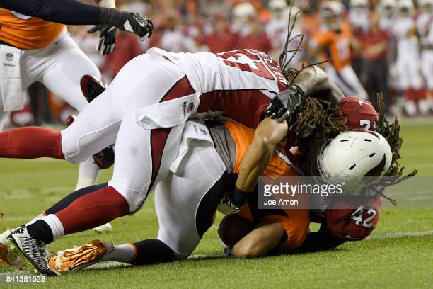 Kyle Sloter of the Denver Broncos is sacked by Philip Wheeler and Cap Capi of the Arizona Cardinals during the second quarter of action The Denver...