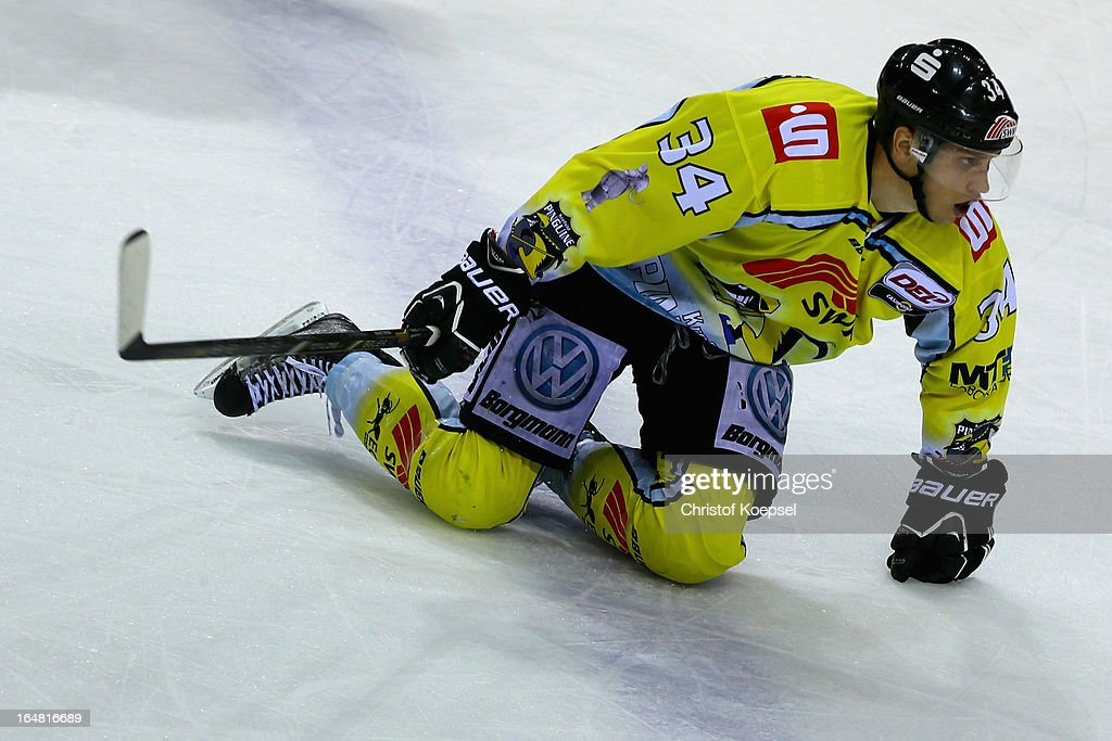 Kyle Sonnenburg of Krefeld Pinguine knees on the ice during the fifth DEL Play-Off-match between Krefeld Pinguine and ERC Ingolstadt at Koenigspalast on March 28, 2013 in Wuppertal, Germany.