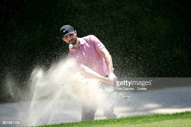 Kyle Stanley chips out of a sand trap on the eighteenth during the fourth round of the Travelers Championship Tournament at the TPC River Highlands...