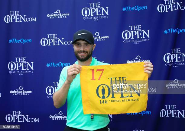 Kyle Stanley holds a hole flag after qualifying for the Open Championship by winning the Quicken Loans National held at TPC Potomac at Avenel Farm on...