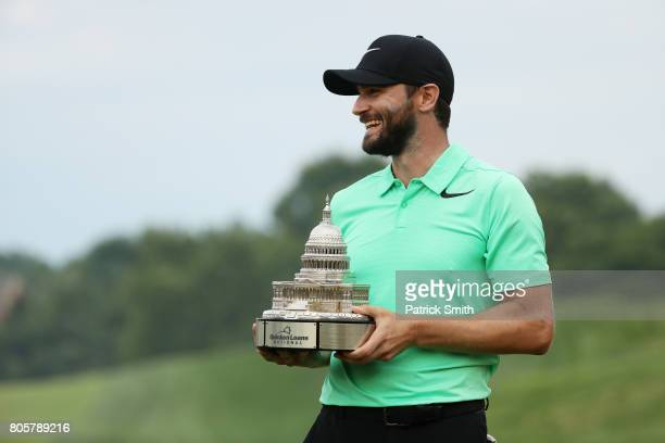 Kyle Stanley of the United States celebrates with the winner's trophy after defeating Charles Howell III of the United States during a playoff in the...
