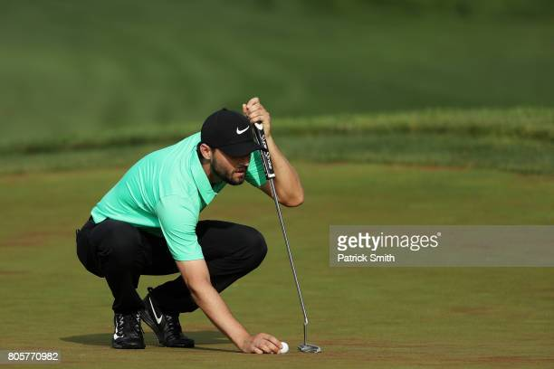 Kyle Stanley of the United States lines up a putt on the 18th green prior to a playoff during the final round of the Quicken Loans National on July 2...