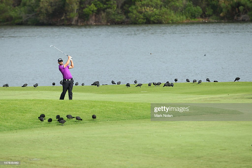 Kyle Stanley of the United States plays a fairway shot during round two of the 2012 Australian Open at The Lakes Golf Club on December 7, 2012 in Sydney, Australia.