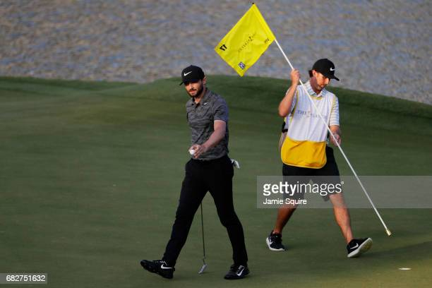 Kyle Stanley of the United States reacts after putting on the 17th green during the third round of THE PLAYERS Championship at the Stadium course at...