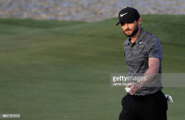 Kyle Stanley of the United States reacts on the 17th green during the third round of THE PLAYERS Championship at the Stadium course at TPC Sawgrass...