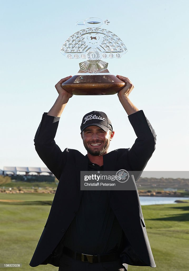 Kyle Stanley poses with the trophy after winning the Waste Management Phoenix Open at TPC Scottsdale on February 5, 2012 in Scottsdale, Arizona.