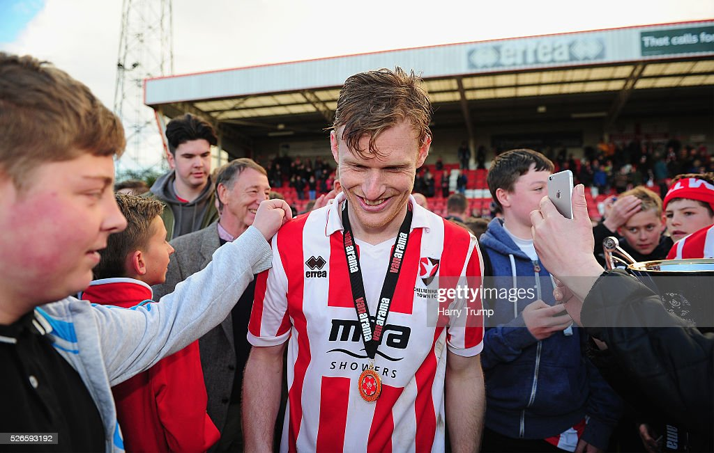 Kyle Storer of Cheltenham Town celebrates with the Cheltenham Town fans during the Vanarama Football Conference match between Cheltenham Town and Lincoln City at the World of Smile Stadium on April 30, 2016 in Cheltenham, England.