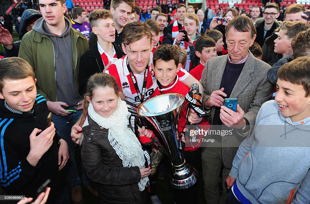 Kyle Storer of Cheltenham Town poses with fans and the Vanarama Conference Trophy during the Vanarama Football Conference match between Cheltenham Town and Lincoln City at the World of Smile Stadium on April 30, 2016 in Cheltenham, England.