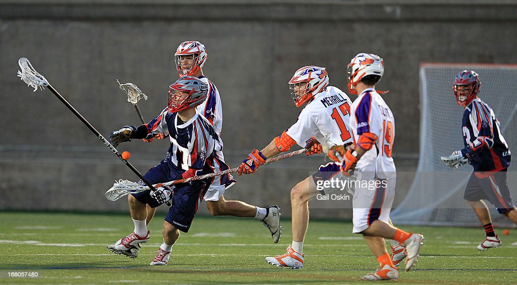 Kyle Sweeney #77 of the Boston Cannons has the ball taken from him by <a gi-track='captionPersonalityLinkClicked' href=/galleries/search?phrase=Brodie+Merrill&family=editorial&specificpeople=5984414 ng-click='$event.stopPropagation()'>Brodie Merrill</a> #77 of the Hamilton Nationals at Harvard Stadium May 4, 2013 in Boston, Massachusetts. The Hamilton Nationals defeated the Boston Cannons 15-8.