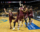 Kyle Thompson Lamarr Kimble Mike Booth DeAndre Bembry and the rest of the Saint Joseph's Hawks celebrate after the game against the Virginia...