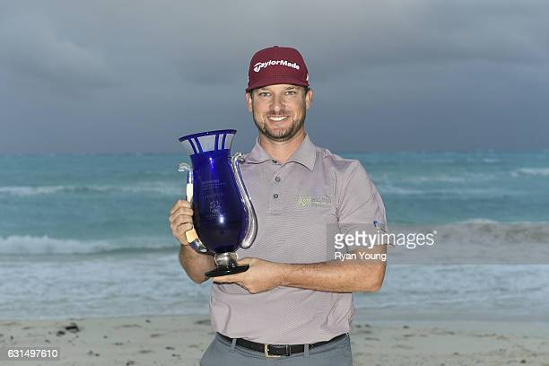 Kyle Thompson poses with the trophy after winning The Bahamas Great Exuma Classic at Sandals Emerald Bay Course on January 11 2017 in Great Exuma...