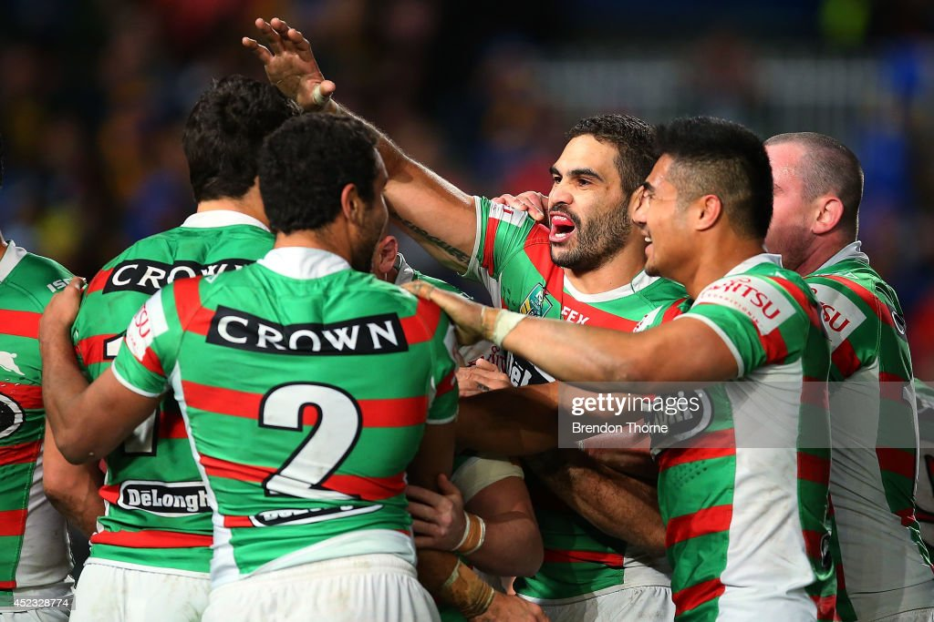 Kyle Turner of the Rabbitohs celebrates with team mates after scoring a try during the round 19 NRL match between the Parramatta Eels and the South Sydney Rabbitohs at Pirtek Stadium on July 18, 2014 in Sydney, Australia.