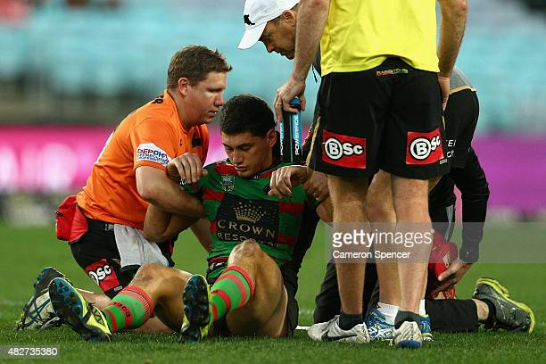 Kyle Turner of the Rabbitohs is assisted from the field after a concussion during the round 21 NRL match between the South Sydney Rabbitohs and the...