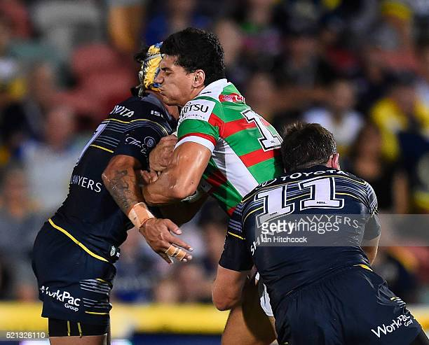 Kyle Turner of the Rabbitohs is tackled by Gavin Cooper and Johnathan Thurston of the Cowboys during the round seven NRL match between the North...