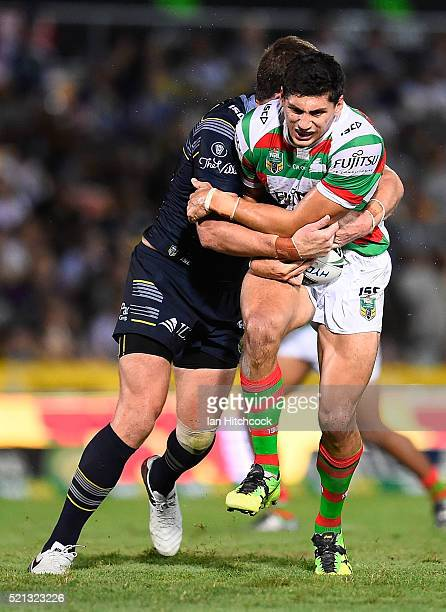 Kyle Turner of the Rabbitohs is tackled by Gavin Cooper of the Cowboys during the round seven NRL match between the North Queensland Cowboys and the...