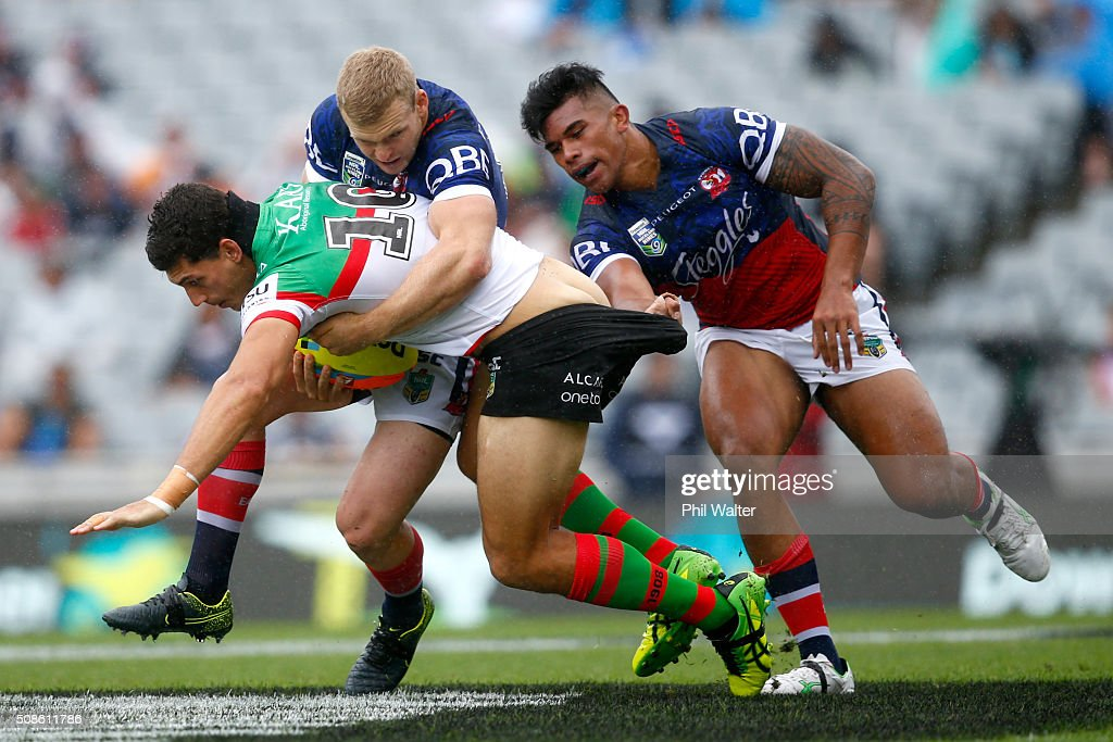 Kyle Turner of the Rabbitohs is tackled during the 2016 Auckland Nines match between the Rabbitohs and the Roosters at Eden Park on February 6, 2016 in Auckland, New Zealand.