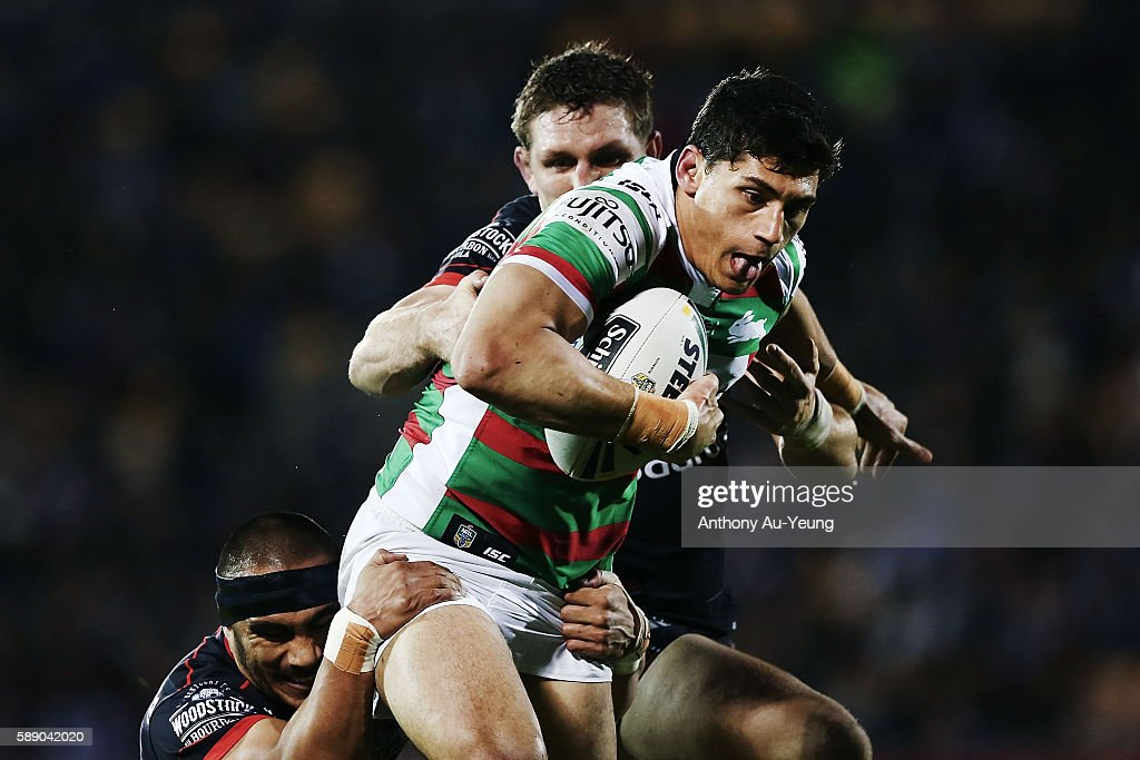Kyle Turner of the Rabbitohs on the charge against Ryan Hoffman of the Warriors during the round 23 NRL match between the New Zealand Warriors and the South Sydney Rabbitohs at Mount Smart Stadium on August 13, 2016 in Auckland, New Zealand.