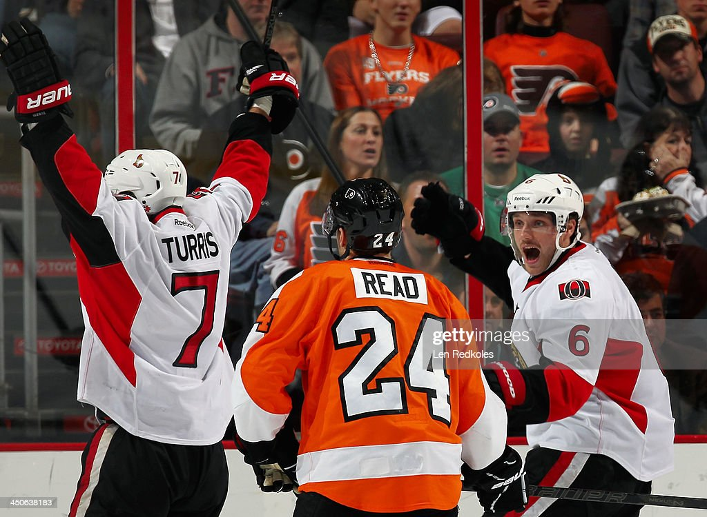 Kyle Turris #7 and Bobby Ryan #6 of the Ottawa Senators celebrate Turris' third-period power-play goal against the Philadelphia Flyers on November 19, 2013 at the Wells Fargo Center in Philadelphia, Pennsylvania.