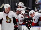Kyle Turris and Chris Neil of the Ottawa Senators react to their 2 to 1 loss to the New York Rangers in Game Seven of the Eastern Conference...