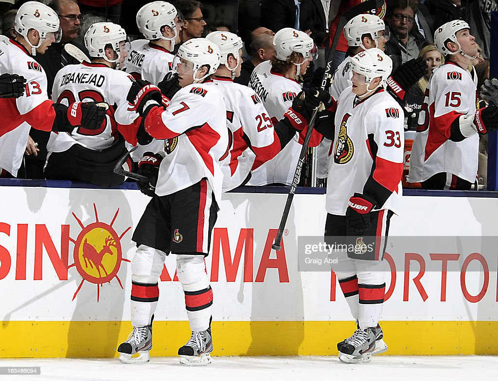Kyle Turris #7 and Jakob Silfverberg #33 of the Ottawa Senators are congratulated by teammates after a goal against the Toronto Maple Leafs during NHL game action March 6, 2013 at the Air Canada Centre in Toronto, Ontario, Canada.
