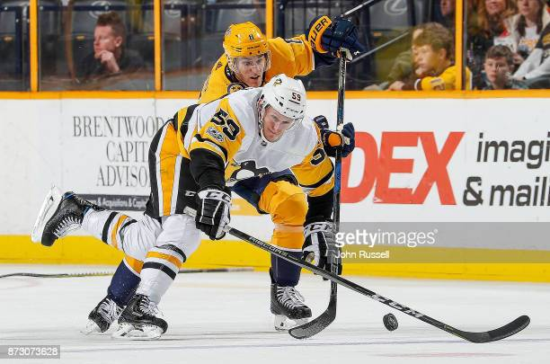 Kyle Turris of the Nashville Predators battles for the puck against Jake Guentzel of the Pittsburgh Penguins during an NHL game at Bridgestone Arena...