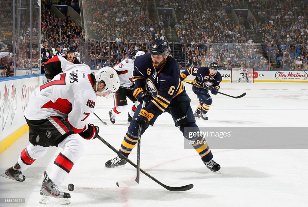 <a gi-track='captionPersonalityLinkClicked' href=/galleries/search?phrase=Kyle+Turris&family=editorial&specificpeople=4251834 ng-click='$event.stopPropagation()'>Kyle Turris</a> #7 of the Ottawa Senators and Mike Weber #6 of the Buffalo Sabres battle for the puck at First Niagara Center on October 4, 2013 in Buffalo, New York. Ottawa defeated Buffalo 1-0.