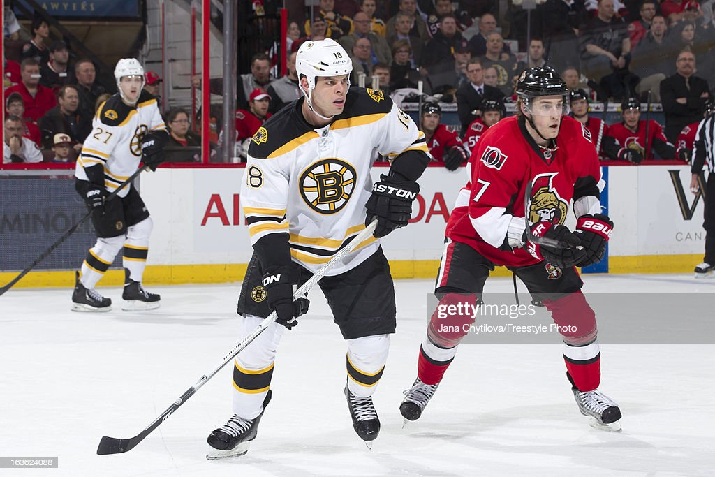 Kyle Turris #7 of the Ottawa Senators and Nathan Horton #18 of the Boston Bruins skate, during an NHL game at Scotiabank Place, on March 11, 2013 in Ottawa, Ontario, Canada.