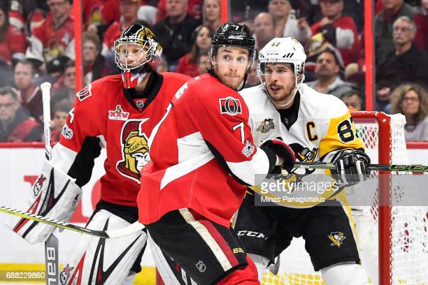 Kyle Turris of the Ottawa Senators and Sidney Crosby of the Pittsburgh Penguins battle for position near goaltender Craig Anderson in Game Six of the...