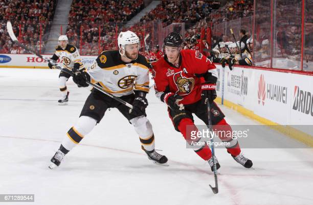 Kyle Turris of the Ottawa Senators battles for position against Colin Miller of the Boston Bruins in Game Five of the Eastern Conference First Round...