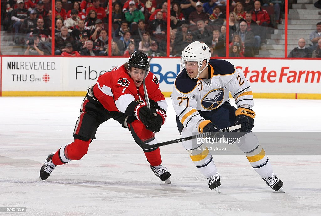 Kyle Turris #7 of the Ottawa Senators battles for position against Matt D'Agostini #27 of the Buffalo Sabres during an NHL game at Canadian Tire Centre on February 6, 2014 in Ottawa, Ontario, Canada.