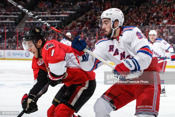 Kyle Turris of the Ottawa Senators battles for position against Mika Zibanejad of the New York Rangers in Game Two of the Eastern Conference Second...