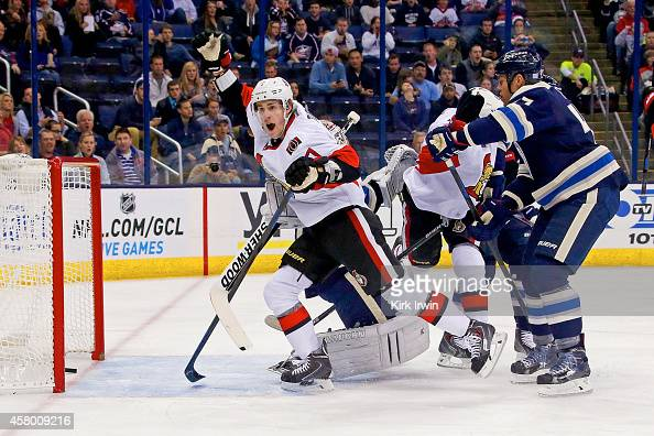 Kyle Turris of the Ottawa Senators celebrates after Clarke MacArthur of the Ottawa Senators redirected a shot past Curtis McElhinney of the Columbus...