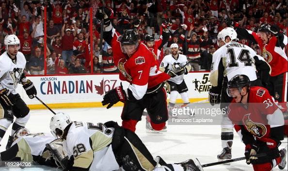 Kyle Turris of the Ottawa Senators celebrates his first period goal as Jakob Silfverberg Erik Karlsson Mark Stone reacts against Tomas Vokoun Matt...
