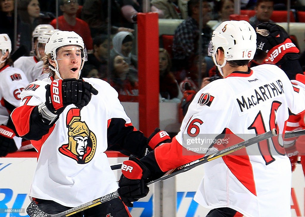 Kyle Turris #7 of the Ottawa Senators celebrates his second goal against the Carolina Hurricanes with teammate Clarke MacArthur #16 during their NHL game at PNC Arena on January 25, 2014 in Raleigh, North Carolina.