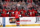 Kyle Turris of the Ottawa Senators celebrates his second period goal with team mates Colin Greening Zack Smith Erik Condra Matt Kassian Jason Spezza...