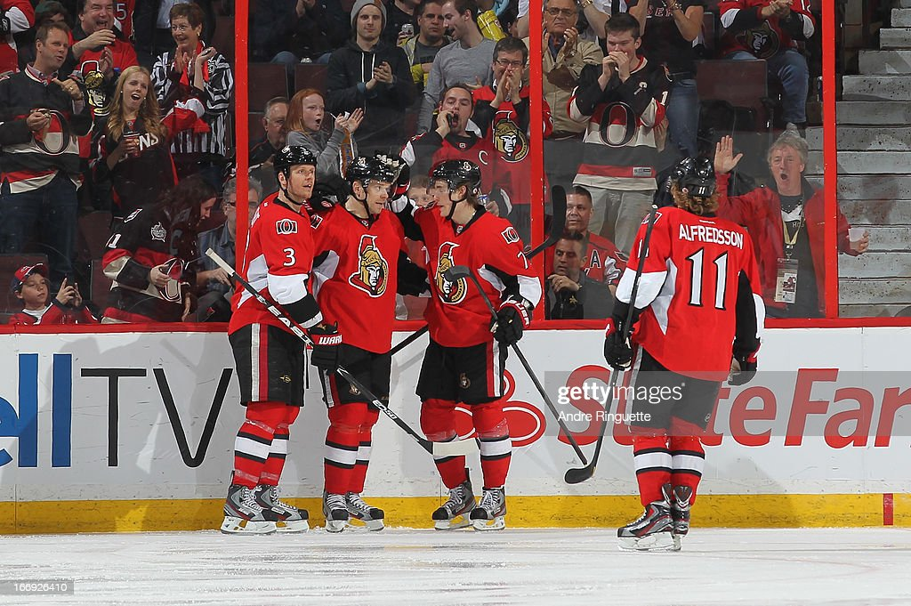 <a gi-track='captionPersonalityLinkClicked' href=/galleries/search?phrase=Kyle+Turris&family=editorial&specificpeople=4251834 ng-click='$event.stopPropagation()'>Kyle Turris</a> #7 of the Ottawa Senators celebrates his second-period goal against the Washington Capitals with teammates <a gi-track='captionPersonalityLinkClicked' href=/galleries/search?phrase=Marc+Methot&family=editorial&specificpeople=2216900 ng-click='$event.stopPropagation()'>Marc Methot</a> #3, <a gi-track='captionPersonalityLinkClicked' href=/galleries/search?phrase=Milan+Michalek&family=editorial&specificpeople=544987 ng-click='$event.stopPropagation()'>Milan Michalek</a> #9 and <a gi-track='captionPersonalityLinkClicked' href=/galleries/search?phrase=Daniel+Alfredsson&family=editorial&specificpeople=201853 ng-click='$event.stopPropagation()'>Daniel Alfredsson</a> #11 on April 18, 2013 at Scotiabank Place in Ottawa, Ontario, Canada.
