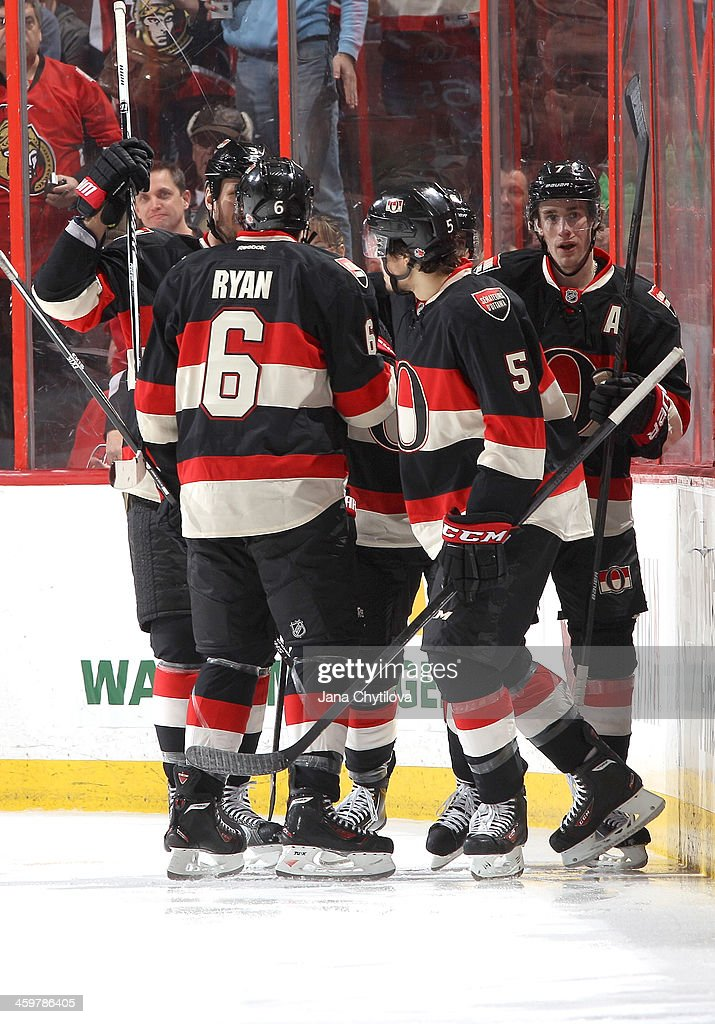 Kyle Turris #7 of the Ottawa Senators celebrates his second-period goal with teammates Bobby Ryan #6 and Cody Ceci #5 against the Washington Capitals during an NHL game at Canadian Tire Centre on December 30, 2013 in Ottawa, Ontario, Canada.