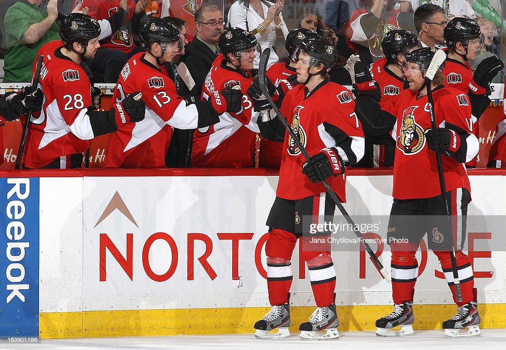 Kyle Turris #7 of the Ottawa Senators celebrates his third period goal with teammates Daniel Alfredsson #11, Matt Kassian #28, Peter Regin #13, and Jakob Silfverberg #33, during an NHL game against the Winnipeg Jets at Scotiabank Place, on March 17, 2013 in Ottawa, Ontario, Canada.