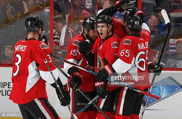 Kyle Turris of the Ottawa Senators celebrates his third period goal against the Toronto Maple Leafs with teammates Marc Methot Zack Smith and Erik...