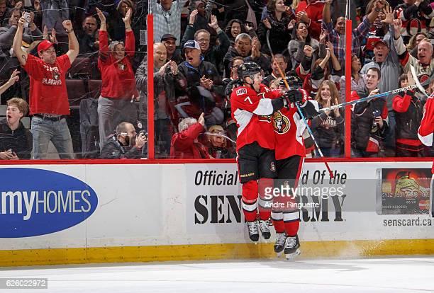 Kyle Turris of the Ottawa Senators celebrates his third period gamewinning goal against the Carolina Hurricanes with teammate Erik Karlsson at...