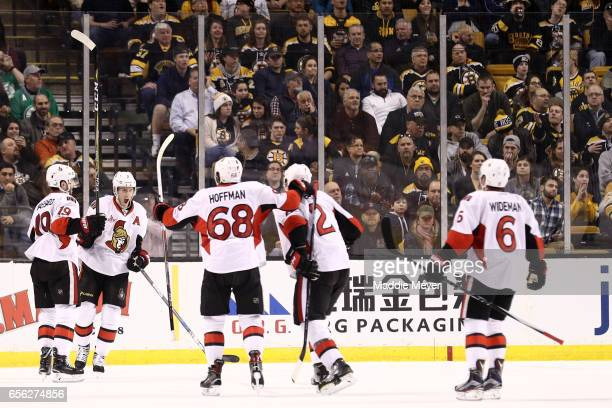 Kyle Turris of the Ottawa Senators celebrates with Derick Brassard Mike Hoffman Dion Phaneuf and Chris Wideman after scoring against the Boston...