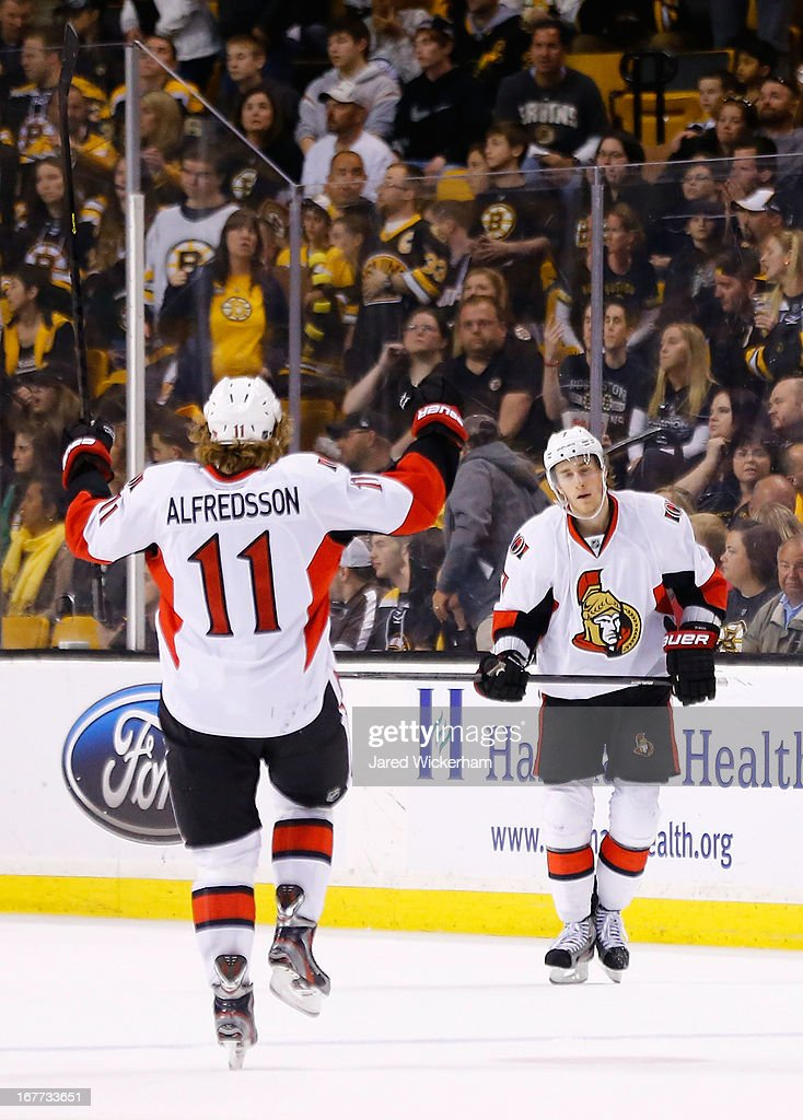 Kyle Turris #7 of the Ottawa Senators celebrates with teammate Daniel Alfredsson #11 of the Ottawa Senators on an empty-net goal in the third period to go up 4-2 against the Boston Bruins during the game on April 28, 2013 at TD Garden in Boston, Massachusetts.
