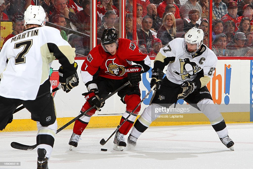 <a gi-track='captionPersonalityLinkClicked' href=/galleries/search?phrase=Kyle+Turris&family=editorial&specificpeople=4251834 ng-click='$event.stopPropagation()'>Kyle Turris</a> #7 of the Ottawa Senators controls the puck against <a gi-track='captionPersonalityLinkClicked' href=/galleries/search?phrase=Sidney+Crosby&family=editorial&specificpeople=212781 ng-click='$event.stopPropagation()'>Sidney Crosby</a> #87 of the Pittsburgh as Paul Martin #7 defends in Game Three of the Eastern Conference Semifinals during the 2013 NHL Stanley Cup Playoffs at Scotiabank Place on May 19, 2013 in Ottawa, Ontario, Canada.