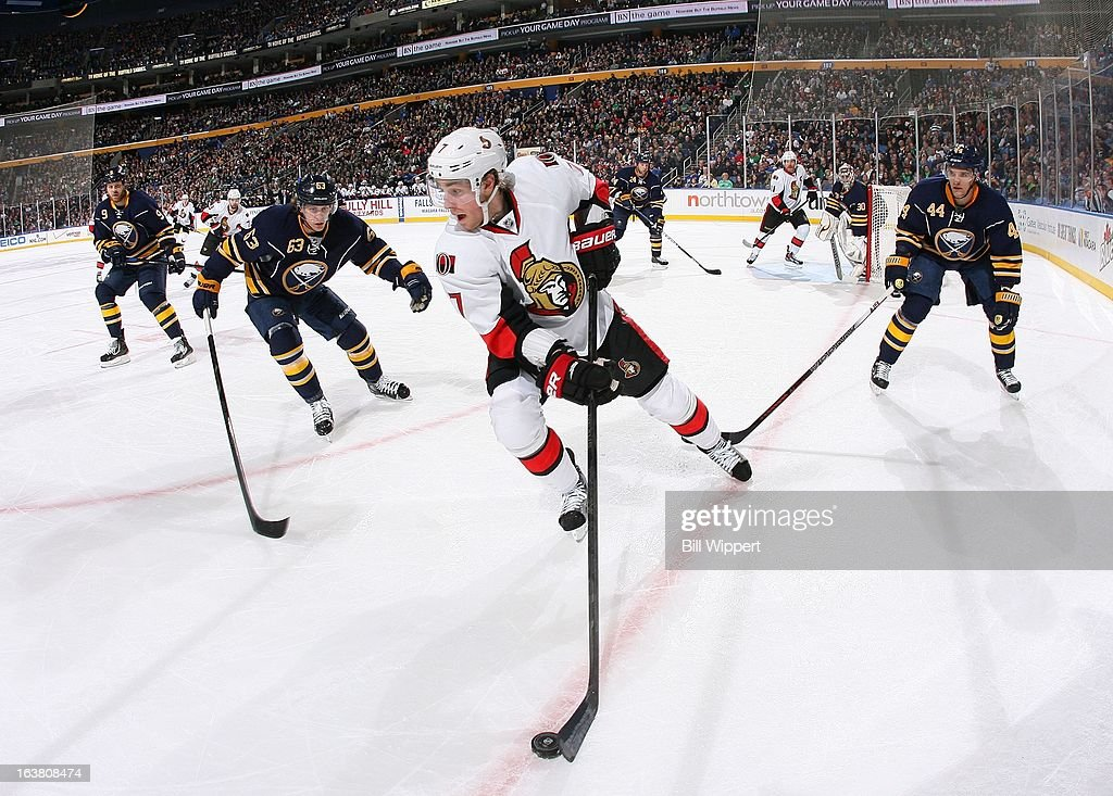 <a gi-track='captionPersonalityLinkClicked' href=/galleries/search?phrase=Kyle+Turris&family=editorial&specificpeople=4251834 ng-click='$event.stopPropagation()'>Kyle Turris</a> #7 of the Ottawa Senators controls the puck in the corner against <a gi-track='captionPersonalityLinkClicked' href=/galleries/search?phrase=Tyler+Ennis+-+Ice+Hockey+Player&family=editorial&specificpeople=4754184 ng-click='$event.stopPropagation()'>Tyler Ennis</a> #63 and <a gi-track='captionPersonalityLinkClicked' href=/galleries/search?phrase=Andrej+Sekera&family=editorial&specificpeople=722503 ng-click='$event.stopPropagation()'>Andrej Sekera</a> #44 of the Buffalo Sabres on March 16, 2013 at the First Niagara Center in Buffalo, New York.