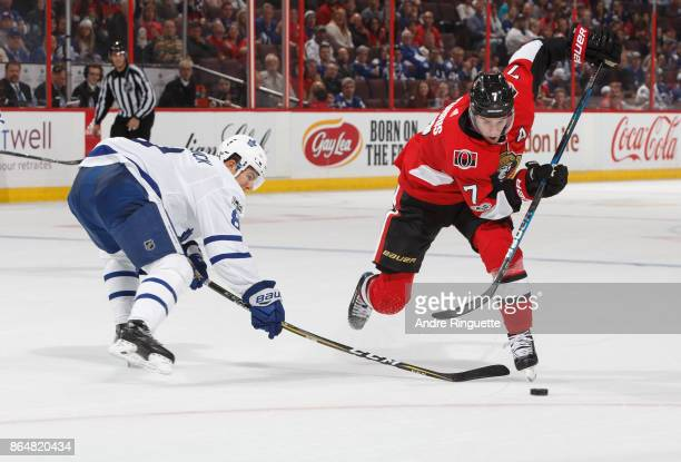 Kyle Turris of the Ottawa Senators dangles the puck past Connor Carrick of the Toronto Maple Leafs at Canadian Tire Centre on October 21 2017 in...