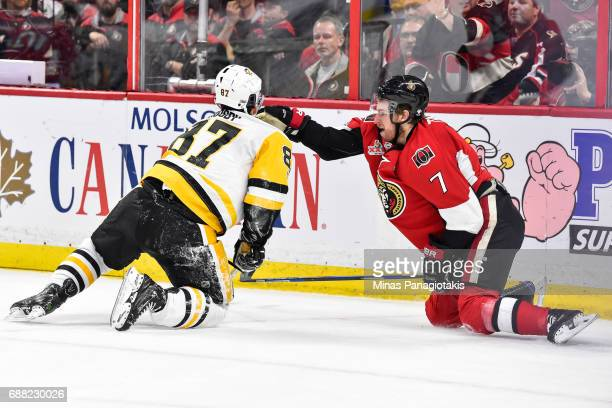 Kyle Turris of the Ottawa Senators defends against Sidney Crosby of the Pittsburgh Penguins in Game Six of the Eastern Conference Final during the...